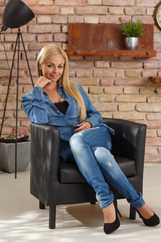 Beautiful blonde in armchair